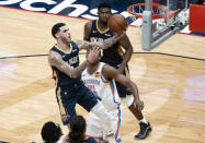 New Orleans Pelicans guard Lonzo Ball (2) shoots past Oklahoma City Thunder center Al Horford (42) in the fourth quarter of an NBA basketball game in New Orleans, Wednesday, Jan. 6, 2021. (AP Photo/Derick Hingle)