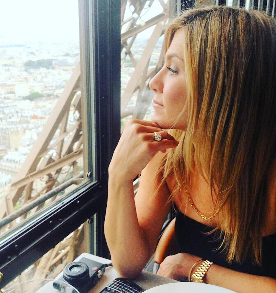"""<p>Speaking of romance, Jennifer Aniston dined with Justin Theroux at the Eiffel Tower in February 2016. He shared this photo of his new bride (and that blinding ring!) that he captioned with a rose. (Photo: <a rel=""""nofollow noopener"""" href=""""https://www.instagram.com/p/BByQX_mQ4nS/?hl=en"""" target=""""_blank"""" data-ylk=""""slk:Justin Theroux via Instagram"""" class=""""link rapid-noclick-resp"""">Justin Theroux via Instagram</a>) </p>"""