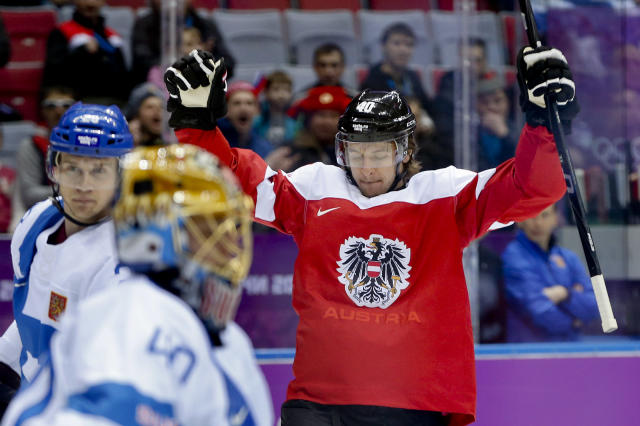 Austria forward Michael Rene Grabner reacts after scoring a goal against Finland in the first period of a men's ice hockey game at the 2014 Winter Olympics, Thursday, Feb. 13, 2014, in Sochi, Russia. (AP Photo/Julio Cortez)