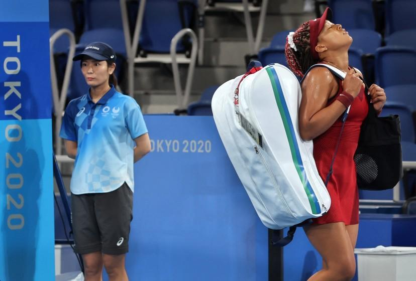 Naomi Osaka leaves the court after being beaten by Marketa Vondrousova during their Olympic tennis match