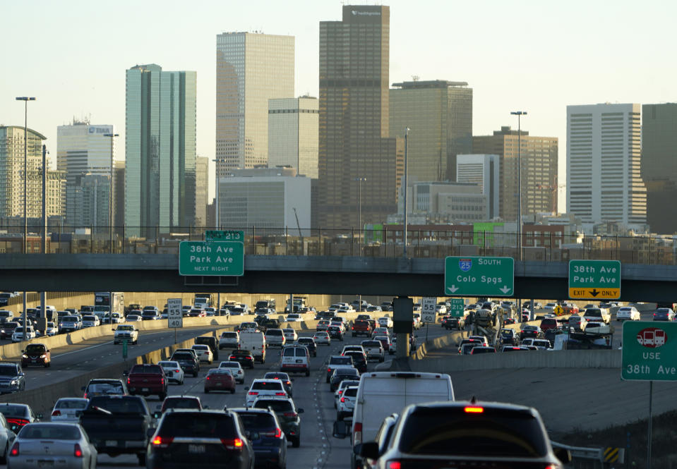 FILE—Motorists face a heavy traffic backup in this file photograph taken late Thursday, Jan. 14, 2021, in Denver. After booming population growth over the past decade, Colorado will gain an eighth U.S. House seat following the release of new U.S. Census Bureau date on Monday, April 26, 2021. (AP Photo/David Zalubowski, File)