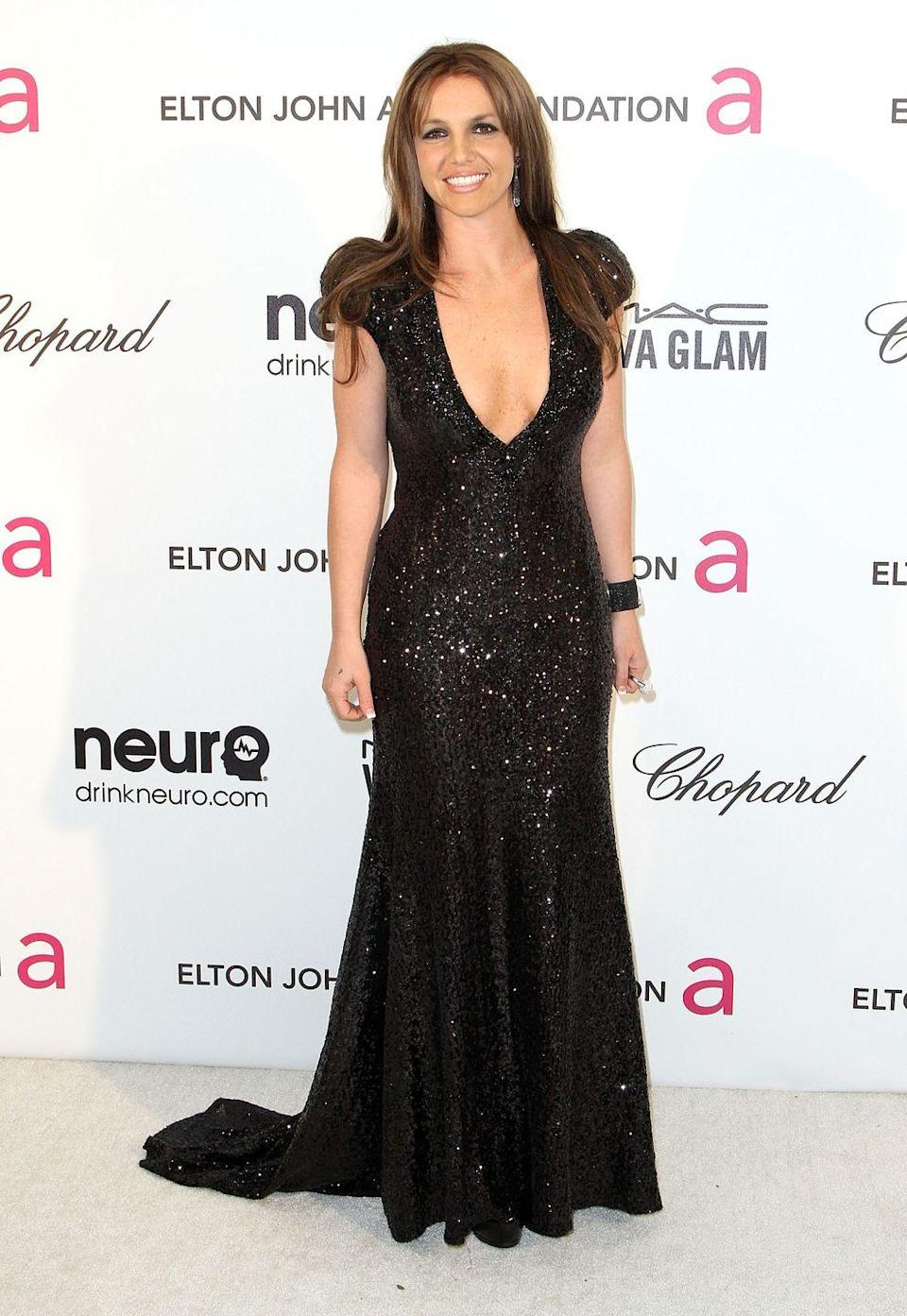 <p>Photos of brunette Britney are few and far between, but j'adore this one of her with a stunning dark and sparkly gown to match her equally dark do. </p>