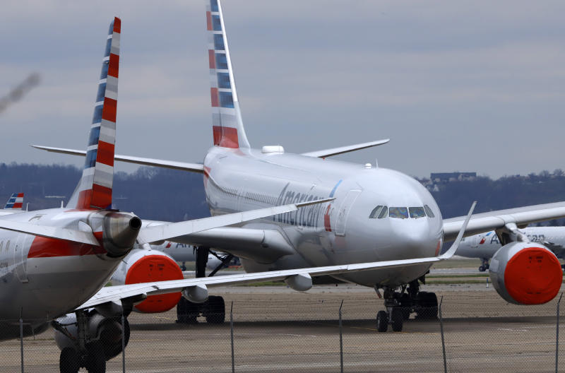 These are some of the 88 American Airlines planes stored at Pittsburgh International Airport in Imperial, Pa., on Tuesday, March 31, 2020. As airlines cut more service, due to the COVID-19 pandemic, Pittsburgh International Airport has closed one of its four runways to shelter in place 96 planes, mostly from American Airlines, as of Monday, March 30, 2020. The airport has the capacity to store 140 planes.(AP Photo/Gene J. Puskar)