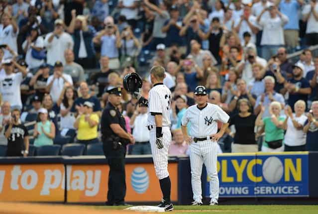 NEW YORK, NY - AUGUST 21: Ichiro Suzuki #31 of the New York Yankees acknowledges fans after his 4000th career hit on a single in the 1st inning of the New York Yankees game against the Toronto Blue Jays at Yankee Stadium on August 21, 2013 in the Bronx borough of New York City. (Photo by Ron Antonelli/Getty Images)