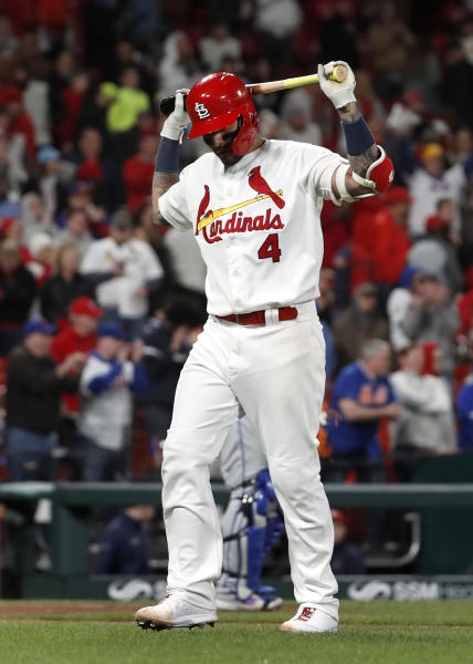 St. Louis Cardinals' Yadier Molina reacts after flying out to end a baseball game against the New York Mets on Friday, April 19, 2019, in St. Louis. The Mets won 5-4. (AP Photo/Jeff Roberson)