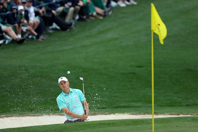 Jordan Spieth of the U.S. chips to the 16th green during third round play of the 2018 Masters golf tournament at the Augusta National Golf Club in Augusta, Georgia, U.S. April 7, 2018. REUTERS/Lucy Nicholson