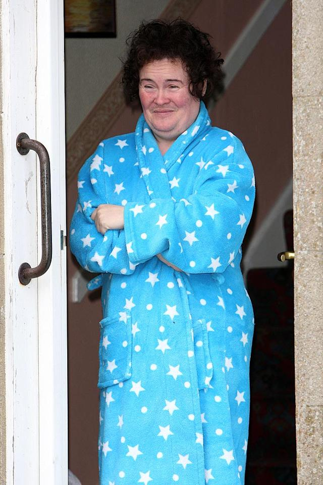 "It looks like ""Britain's Got Talent"" sensation Susan Boyle (seen here at her home in Scotland on Thursday) still hasn't gotten used to her new hair, or all the attention. Pete Goddard/<a href=""http://www.splashnewsonline.com"" target=""new"">Splash News</a> - April 30, 2009"