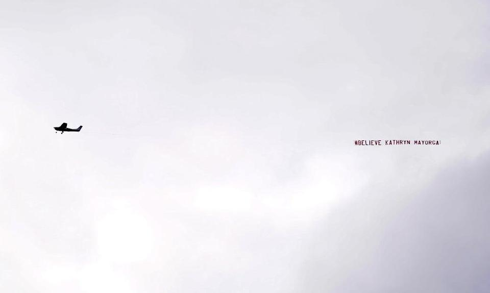 A banner reading '#Believe Kathryn Mayorga' flies over the stadium during the Premier League match at Old Trafford (PA Wire)
