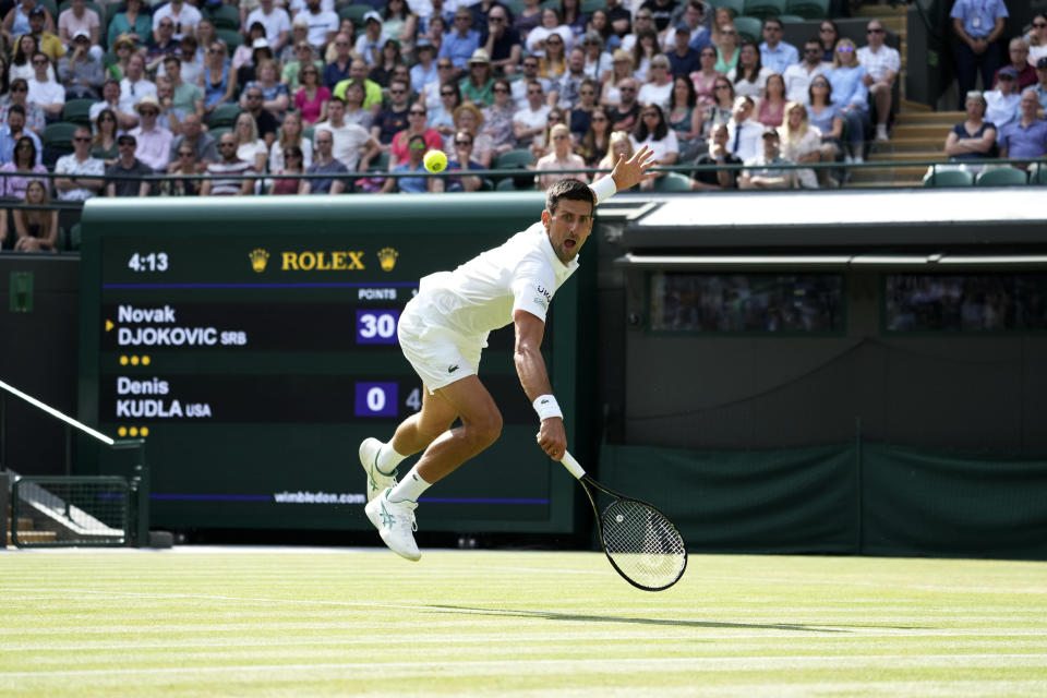 Serbia's Novak Djokovic plays a return to Denis Kudla of the US during the men's singles third round match on day five of the Wimbledon Tennis Championships in London, Friday July 2, 2021. (AP Photo/Alberto Pezzali)