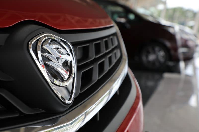 A Proton logo is seen on a car at its headquarters in Subang Jaya