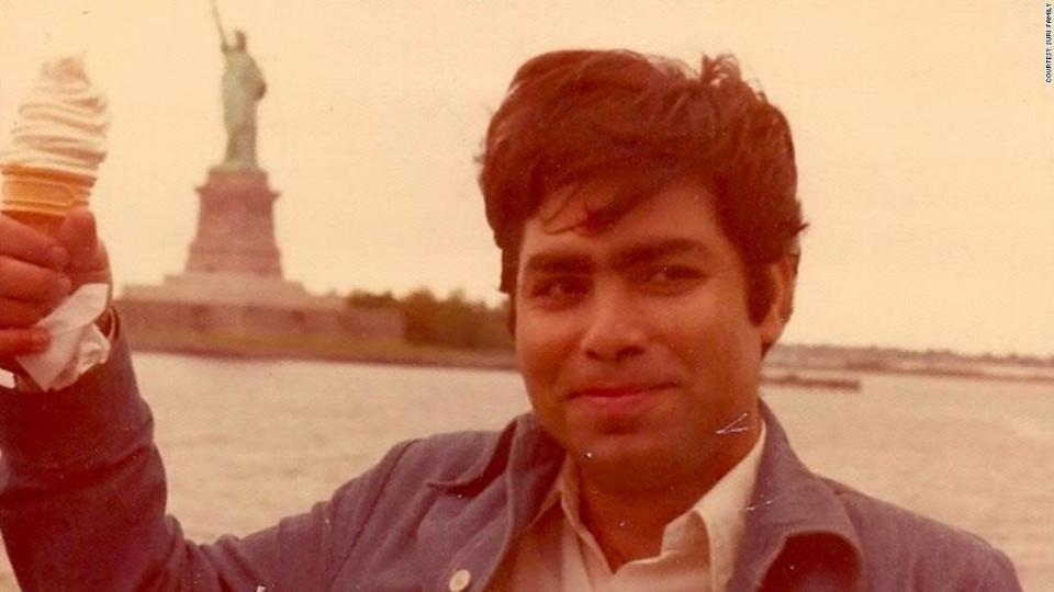 """<p>Gireesh Kumar Suri died at age 67 last week. He is pictured here with the Statue of Liberty, not long after he arrived in America.</p><div class=""""cnn--image__credit""""><em><small>Credit: Courtesy Suri Family / Handout</small></em></div>"""