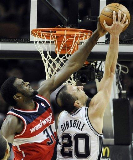 Washington Wizards forward Chris Singleton blocks a shot attempt by San Antonio Spurs guard Manu Ginobili, of Argentina, during the first half of an NBA basketball game, Monday, March 12, 2012, in San Antonio. (AP Photo/Bahram Mark Sobhani)