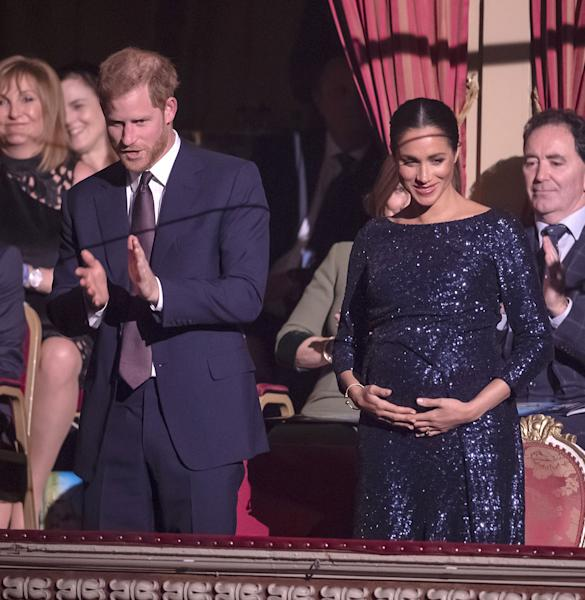 Duchess Meghan stunned at a gala in a slinky blue gown and one of Princess Diana's bracelets. Earlier, she laughed when a fan called her a 'fat lady.'