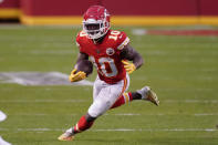 Kansas City Chiefs wide receiver Tyreek Hill runs up field after catching a pass during the second half of an NFL divisional round football game against the Cleveland Browns, Sunday, Jan. 17, 2021, in Kansas City. The Chiefs won 22-17. (AP Photo/Charlie Riedel)