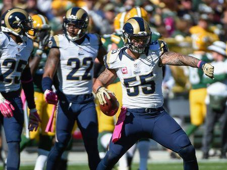 Oct 11, 2015; Green Bay, WI, USA; St. Louis Rams linebacker James Laurinaitis (55) celebrates after intercepting a pass in the first quarter during the game against the Green Bay Packers at Lambeau Field. Mandatory Credit: Benny Sieu-USA TODAY Sports / Reuters Picture Supplied by Action Images
