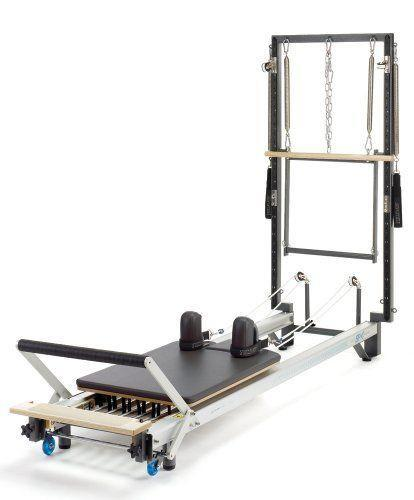 """<p><strong>STOTT PILATES</strong></p><p>amazon.com</p><p><strong>$5199.00</strong></p><p><a href=""""https://www.amazon.com/dp/B002ABUTSK?tag=syn-yahoo-20&ascsubtag=%5Bartid%7C2140.g.32850611%5Bsrc%7Cyahoo-us"""" rel=""""nofollow noopener"""" target=""""_blank"""" data-ylk=""""slk:Shop Now"""" class=""""link rapid-noclick-resp"""">Shop Now</a></p><p>Ready to take your Pilates practice up a notch? Then this next-level Pilates machine is worth considering because it can be used as both a Cadillac and a reformer. Plus, it's stackable making it easier to store when it's not in use. </p><p><strong>Reviewer rave: </strong>""""Awesome reformer. As close to the studio one as you can get. I love using it and it helps with my RA a ton.""""</p>"""