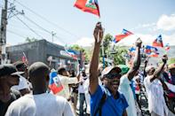 Haitians demonstrate in March 2021 against a constitutional referendum proposed by the President Jovenel Moise