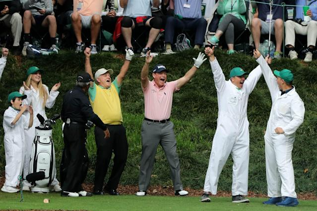 Jack Nicklaus (wearing yellow) celebrates after his grandson Gary (R) made a hole-in-one on the 9th hole during the par 3 contest held on the final day of practice for the 2018 Masters golf tournament at Augusta National Golf Club in Augusta, Georgia, U.S. April 4, 2018. REUTERS/Lucy Nicholson