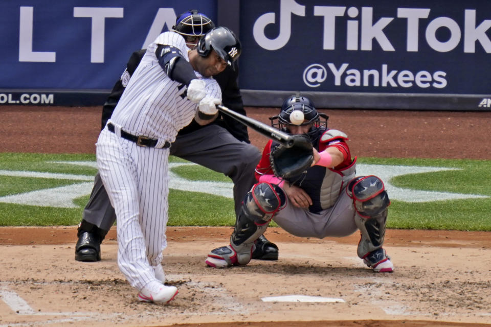 New York Yankees' Aaron Hicks hits an RBI-single during the third inning of a baseball game against the Washington Nationals at Yankee Stadium, Sunday, May 9, 2021, in New York. (AP Photo/Seth Wenig)