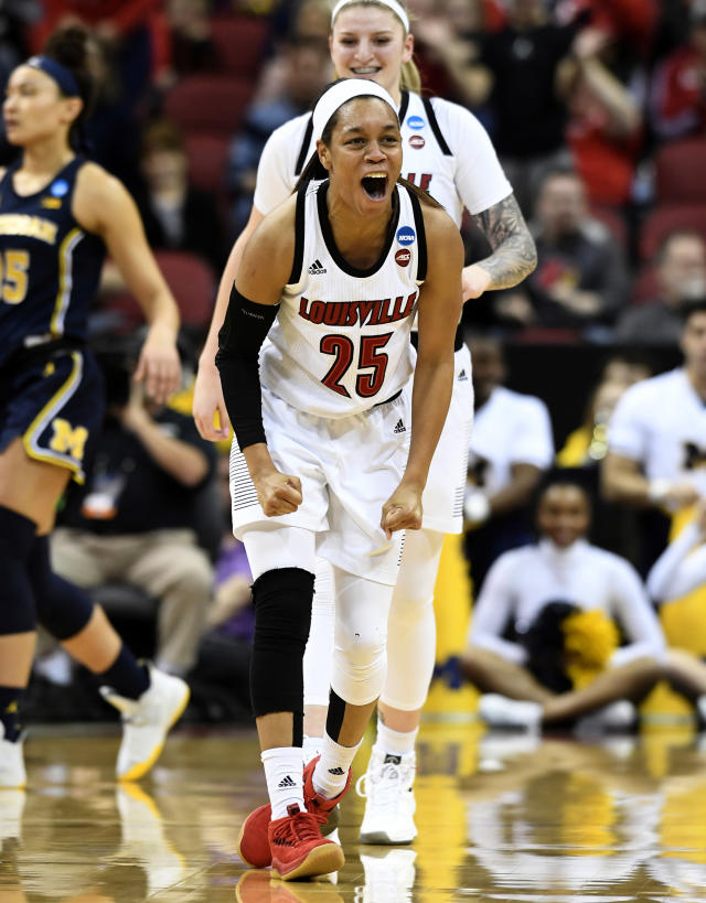 Louisville guard Asia Durr (25) celebrates following a basket where she was fouled on the shot during the first half of a second-round game in the NCAA women's college basketball tournament in Louisville, Ky., Sunday, March 24, 2019. (AP Photo/Timothy D. Easley)