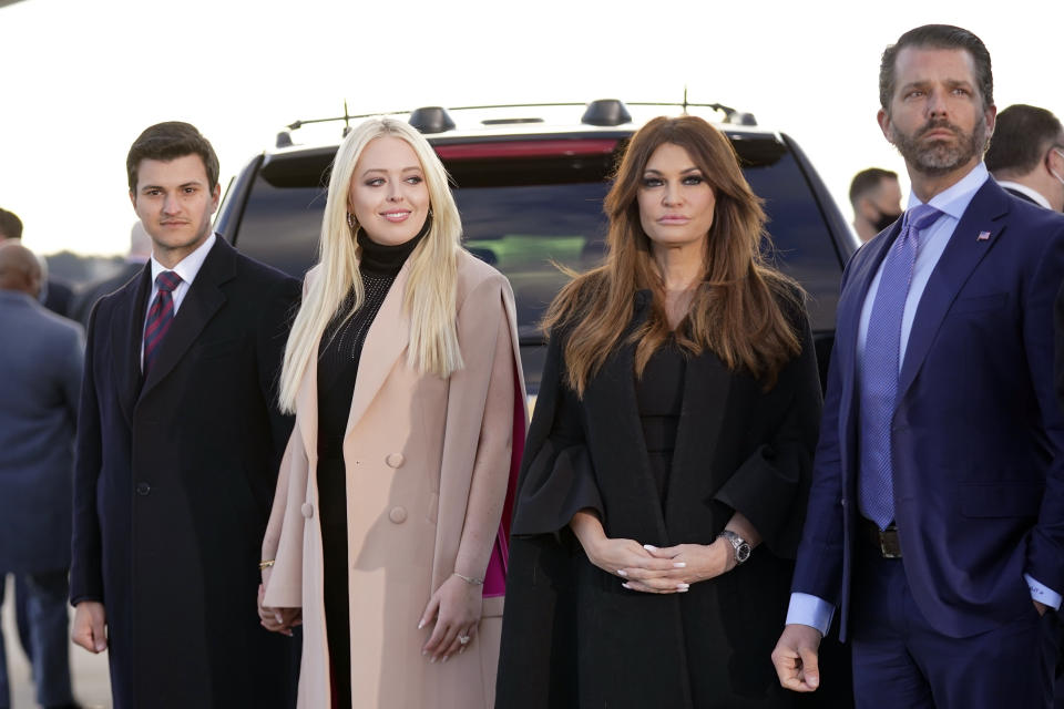 Tiffany Trump and her fiancé Michael Boulos, left, and Donald Trump Jr., and his girlfriend Kimberly Guilfoyle, wait for President Donald Trump and First Lady Melania Trump to arrive and board Air Force One for a final time at Andrews Air Force Base, Md., Wednesday, Jan. 20, 2021.(AP Photo/Manuel Balce Ceneta)