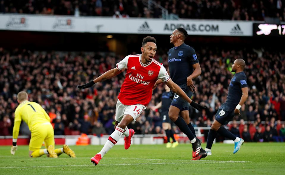 """Soccer Football - Premier League - Arsenal v Everton - Emirates Stadium, London, Britain - February 23, 2020  Arsenal's Pierre-Emerick Aubameyang celebrates scoring their second goal   Action Images via Reuters/Peter Cziborra  EDITORIAL USE ONLY. No use with unauthorized audio, video, data, fixture lists, club/league logos or """"live"""" services. Online in-match use limited to 75 images, no video emulation. No use in betting, games or single club/league/player publications.  Please contact your account representative for further details."""