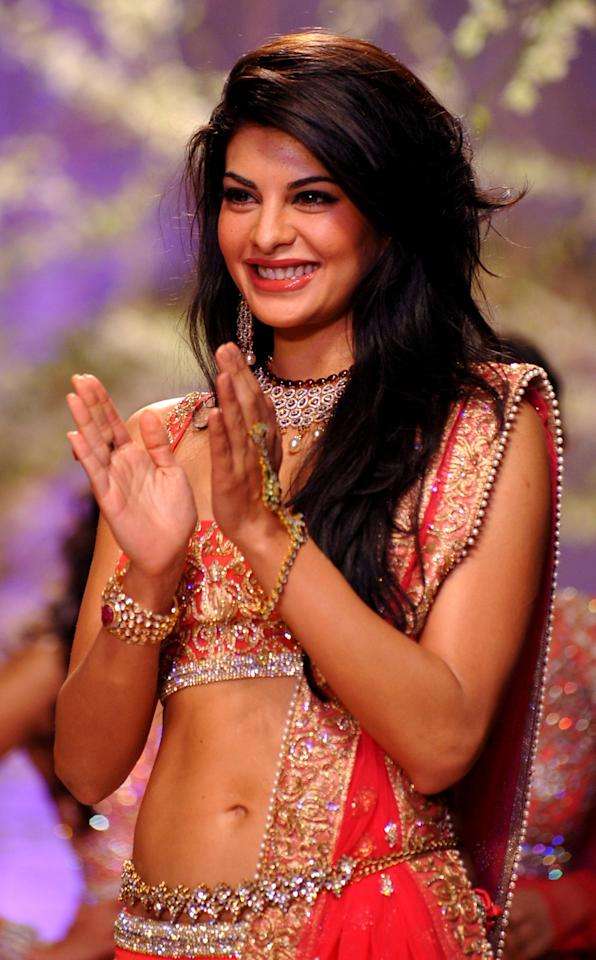 Jacqueline Fernandez showcases a creation by designer Jyotsna Tiwari during the 'Aamby Valley India Bridal Fashion Week' in Mumbai on November 2013.