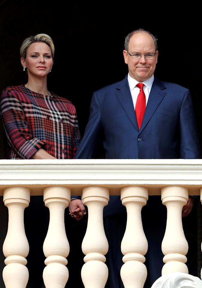 Prince Albert II of Monaco and his wife Princess Charlene stand on the palace balcony during the traditional Sainte Devote procession in Monaco, January 27, 2018.     REUTERS/Eric Gaillard