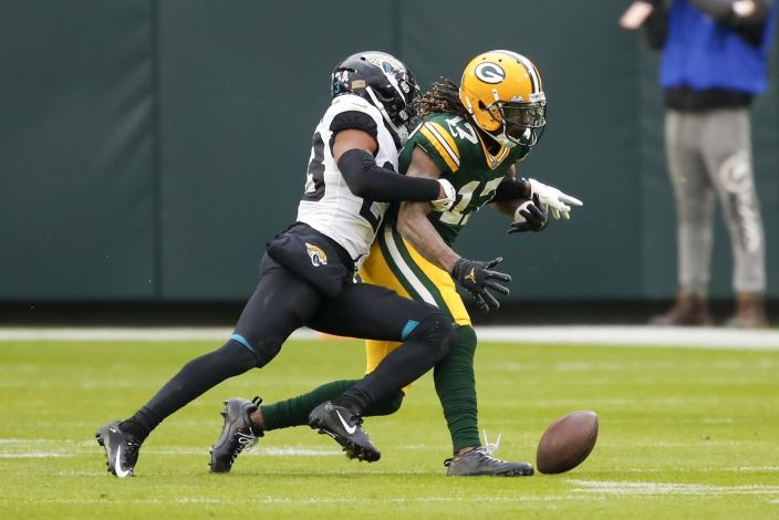 Jacksonville Jaguars' C.J. Henderson knocks the ball away from Green Bay Packers' Davante Adams after a catch during the second half of an NFL football game Sunday, Nov. 15, 2020, in Green Bay, Wis. The Jaguars recovered the fumble. (AP Photo/Matt Ludtke)