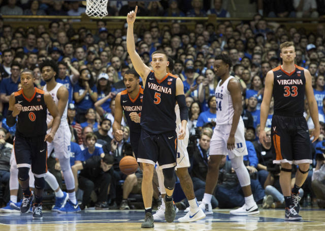 "Virginia's <a class=""link rapid-noclick-resp"" href=""/ncaab/players/136059/"" data-ylk=""slk:Kyle Guy"">Kyle Guy</a> (5) leads his team off the court following a 65-63 victory over Duke in an NCAA college basketball game against Duke in Durham, N.C., Saturday, Jan. 27, 2018. (AP Photo/Ben McKeown)"
