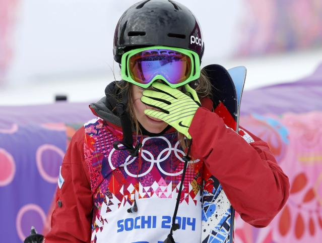 Canada's Kaya Turski reacts after crashing during the women's freestyle skiing slopestyle qualification event at the 2014 Sochi Winter Olympic Games in Rosa Khutor February 11, 2014. REUTERS/Mike Blake (RUSSIA - Tags: SPORT OLYMPICS SPORT SKIING)