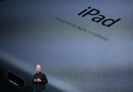 Apple Inc CEO Tim Cook speaks about the new iPad Air during an Apple event in San Francisco, California October 22, 2013. REUTERS/Robert Galbraith