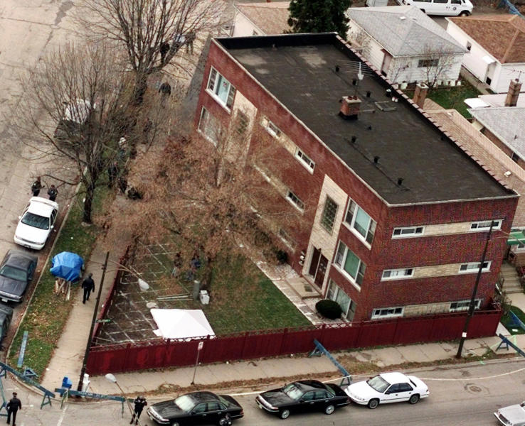 FILE - In this Nov. 23, 1998 file photo, grid patterns are drawn on the lawn where Chicago police planned begin excavating for more possible victims of serial killer John Wayne Gacy. The apartment building is where Gacy's mother used to live. Cook County Sheriff Tom Dart says his officers and the FBI using high tech equipment and two dogs trained to sniff out human remains, went to the apartment complex in March 2013 and found nothing to indicate the serial killer stashed any bodies there. Dart has been investigating the serial killer who was convicted in 1980 of murdering 33 young men in the 1970s on a number of fronts the last couple years. (AP Photo/Charles Bennett, File)