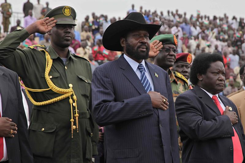 President Salva Kiir, centre, arrives at the John Garang Masoleum in Juba, Sudan, Friday, April 27, 2012, as he is welcomed back to the country by his supporters after an official visit to China.  South Sudan and Sudan have clashed for the past three weeks over the disputed border town of Heglig.(AP Photo/Michael Onyiego)