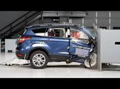 """<p> In 2013 Ford replaced its long in the tooth Mazda-based Escape with a new and improved generation that used its own architecture for Escape and Focus. It worked. Annual Escape sales rose to over 300,000. The IIHS added front small overlap crash tests to its requirements that same year. The Escape rated Poor for both driver- and passenger-side tests, but maintained a Good rating throughout the rest. In 2017 Ford partly remedied this on refreshed Escapes by reinforcing the front structure to improve its Poor overlap crash test, according to the IIHS. This only solved half of the problem. Although the Ford Escape would score higher, this time an Acceptable rating, the necessary improvements were only for the driver's side. The passenger side didn't receive additional structural support, and would still get a Poor rating. The dummy in the front-passenger seat rolled off the side of the front airbag, and the side curtain airbag never deployed. The lower dashboard area of the Escape collapsed far enough to make contact with the occupants knees. Not the case for new 2020 Ford Escape models, which were deemed an IIHS Top Safety Pick, and given a five-star safety rating from the NHTSA. </p><p><a href=""""https://www.youtube.com/watch?v=35W1itsU1P4"""" rel=""""nofollow noopener"""" target=""""_blank"""" data-ylk=""""slk:See the original post on Youtube"""" class=""""link rapid-noclick-resp"""">See the original post on Youtube</a></p>"""