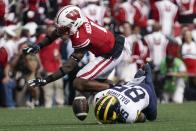 Wisconsin's Faion Hicks breaks up a pass intended for Michigan's Daylen Baldwin during the first half of an NCAA college football game Saturday, Oct. 2, 2021, in Madison, Wis. (AP Photo/Morry Gash)