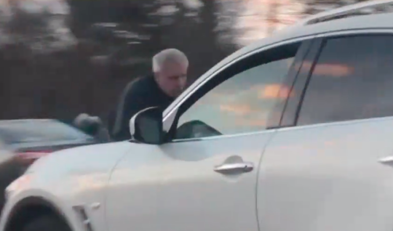 MA man clings to auto hood in alleged road rage incident