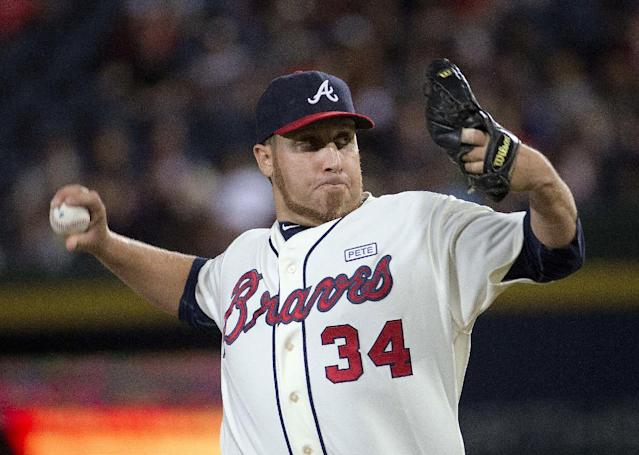 Atlanta Braves starting pitcher Aaron Harang works in the first inning of a baseball game against the Washington Nationals on Saturday, Aug. 9, 2014, in Atlanta. (AP Photo/John Bazemore)
