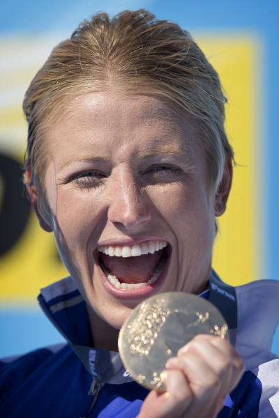 Gold medalist Cesilie Carlton from U.S. poses during the podium ceremony after the women's 20 meter high dive final at the FINA Swimming World Championships in Barcelona, Spain, Tuesday, July 30, 2013. (AP Photo/Daniel Ochoa de Olza)
