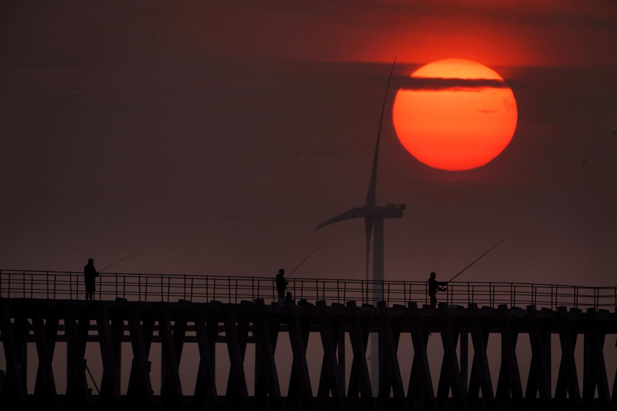 Fishermen on Blyth pier in Northumberland on Tuesday. (PA)