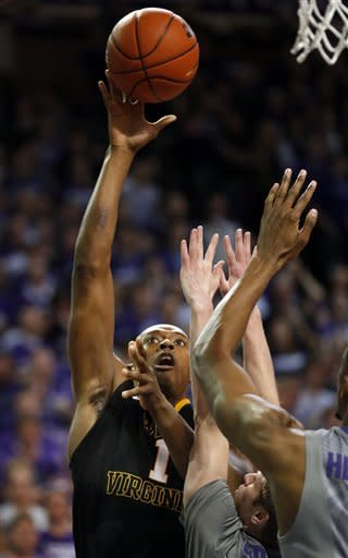 West Virginia forward Dominique Rutledge (1) shoots over Kansas State guard Will Spradling (55) during the first half of an NCAA college basketball game in Manhattan, Kan., Monday, Feb. 18, 2013. (AP Photo/Orlin Wagner)