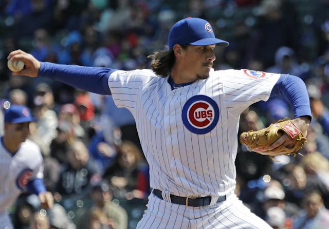 Chicago Cubs starter Jeff Samardzija throws against the Cincinnati Reds during the first inning of a baseball game in Chicago, Friday, April 18, 2014. (AP Photo/Nam Y. Huh)