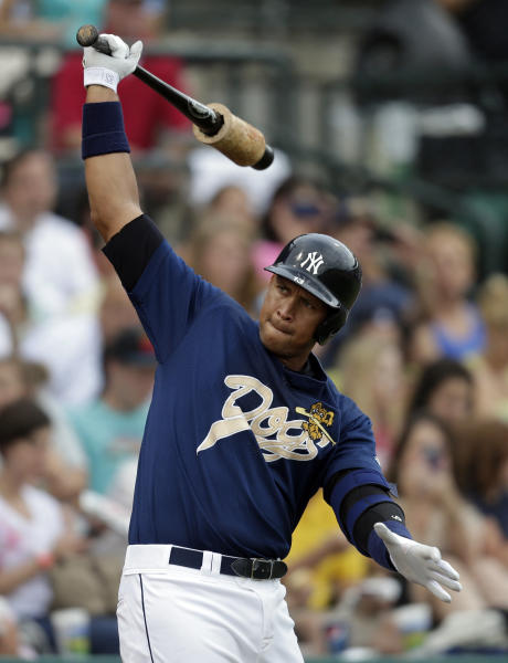 New York Yankees' Alex Rodriguez stretches on the on deck circle during the first inning in his first rehab game with the Charleston RiverDogs in Charleston, S.C., Tuesday, July 2, 2013. (AP Photo/Chuck Burton)