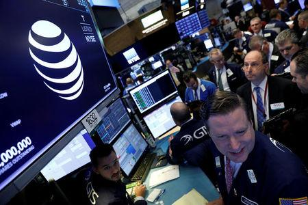 FILE PHOTO: The AT&T logo is seen on a monitor on the NYSE floor.