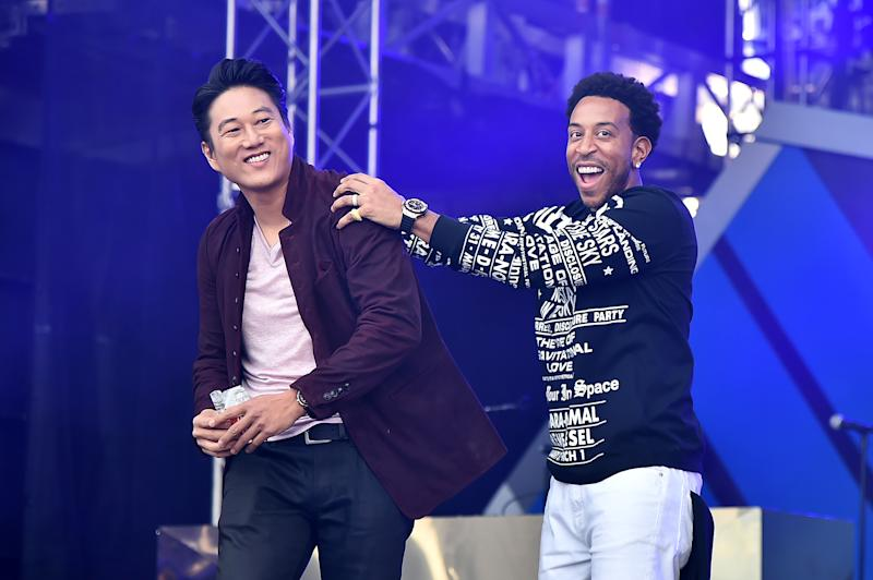 MIAMI, FLORIDA - JANUARY 31: Sung Kang and Ludacris speak onstage during Universal Pictures Presents The Road To F9 Concert and Trailer Drop on January 31, 2020 in Miami, Florida. (Photo by Theo Wargo/Getty Images for Universal Pictures)