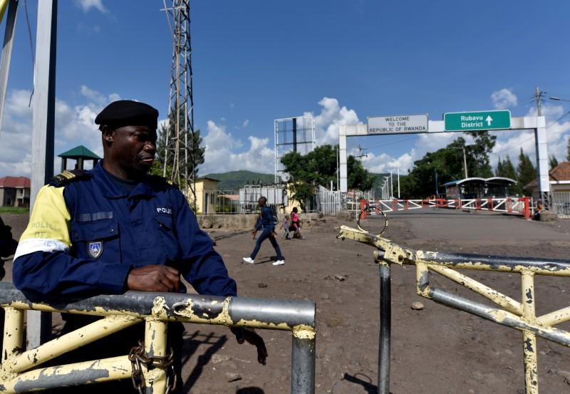 A police officer stands at the deserted crossing point between the Democratic Republic of Congo and Rwanda amid concerns about the spread of coronavirus disease (COVID-19), at the Petite Barriere in Goma