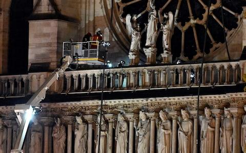Firefighters continue to tackle the fire at the Notre Dame cathedral - Credit: Getty