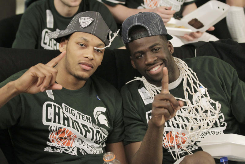 Michigan State center Adreian Payne, left, and forward Draymond Green watch the NCAA Tournament selection show, Sunday, March 11, 2012, in Indianapolis. Michigan State was selected as the No. 1 seed in the NCAA West region. Michigan State beat Ohio St 68-64 earlier Sunday in the final of the Big Ten tournament. (AP Photo/Michael Conroy)