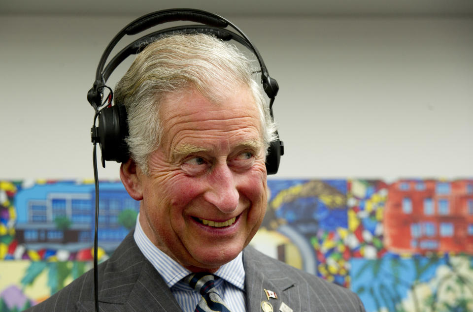 Britain's Prince Charles wears headphones as he learns how to scratch and fade with a turntable while he tours an employment skills workshop in Toronto on May 22, 2012. The royal couple is on a four-day visit to Canada to mark the Queen's Diamond Jubilee.      AFP PHOTO/Paul Chiasson/Pool        (Photo credit should read PAUL CHIASSON/AFP/GettyImages)