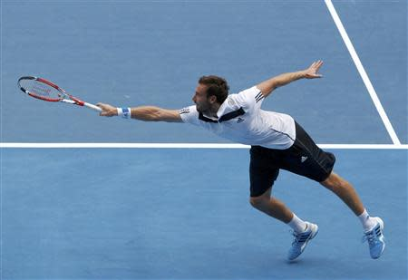 Ernests Gulbis of Latvia hits a return to Sam Querrey of the United States during their men's singles match at the Australian Open 2014 tennis tournament in Melbourne January 15, 2014. REUTERS/Brandon Malone